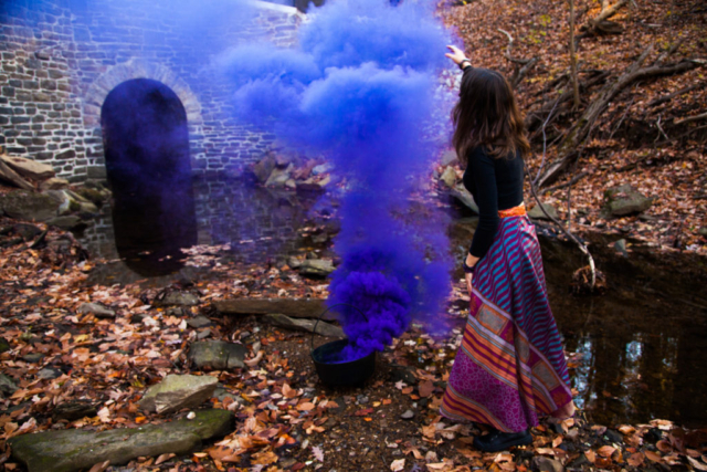 Witchy fashion with purple smoke bomb.